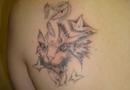 Fantasy cat tattoo